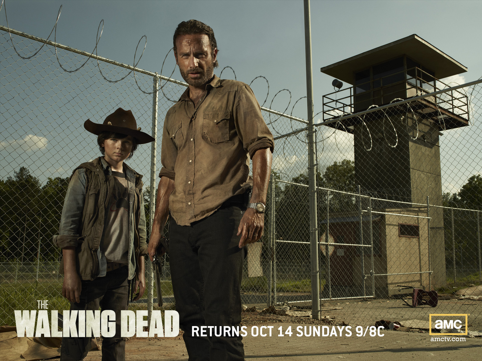 Rick And Carl Grimes At The Prison Wallpaper Background Image