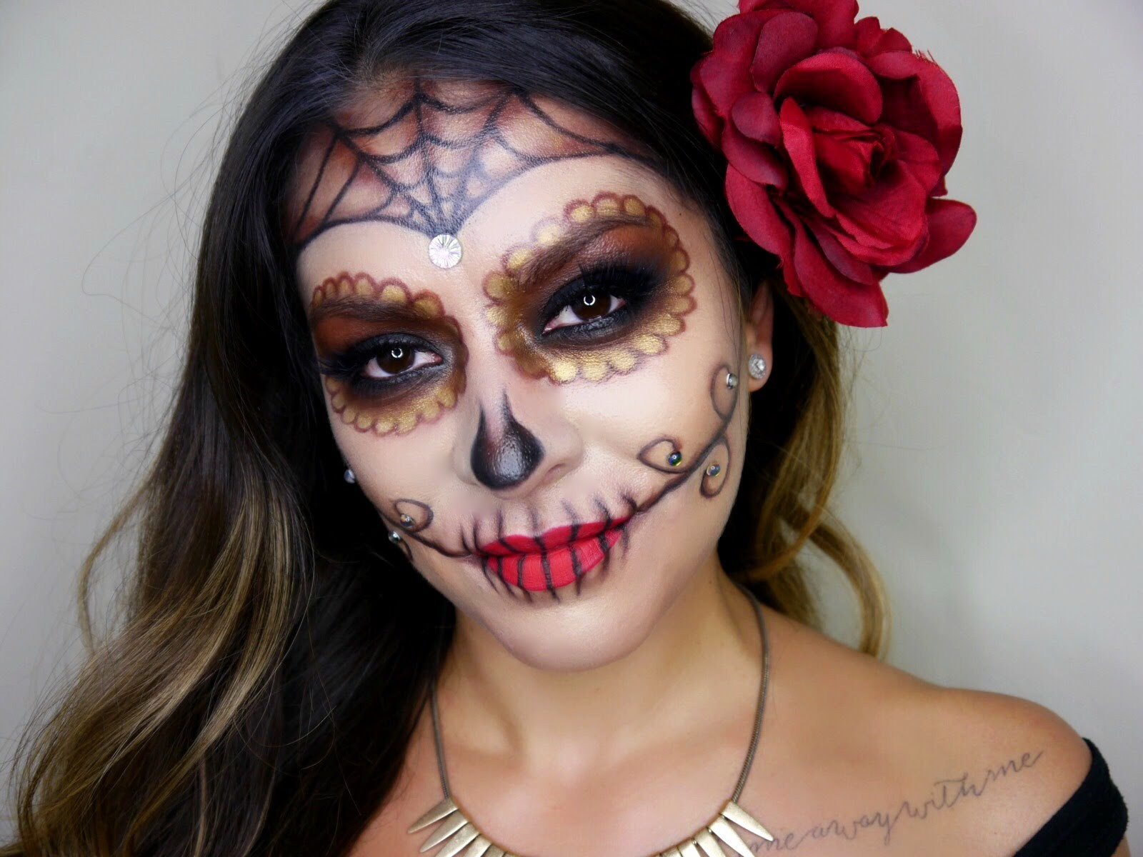 girl with face painted for dia de los muertos day of the