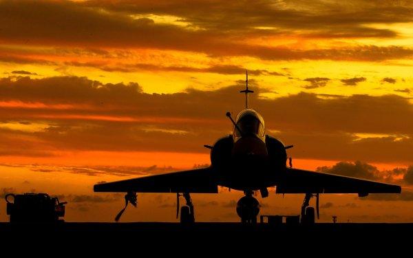 Military Dassault Mirage 2000 Jet Fighters Jet Fighter Aircraft Warplane Silhouette Sky orange HD Wallpaper | Background Image