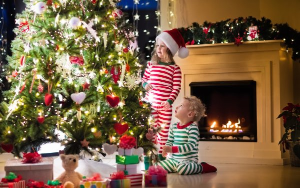 Holiday Christmas Christmas Tree Fireplace Child Little Girl Little Boy Gift Santa Hat HD Wallpaper | Background Image